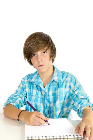 school boy working with a pencil, isolated on white.