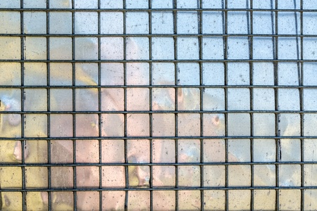 metal grid with mirroring surface in background, photo