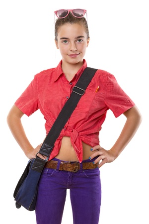 teenage girl with bag an sunglasses ready to go to school, isolated on white. photo