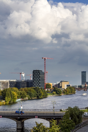 dramatic sky: skyline of berlin with canal and dramatic sky. Stock Photo