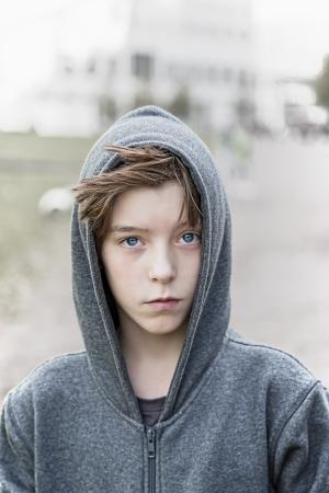 portrait of a teenage boy with grey hoodie sweatshirts. Standard-Bild