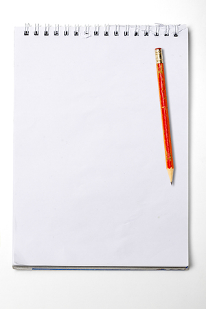 used blank note book with ring binder and old pencil, isolated on white. photo