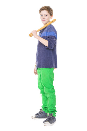 happy teenage boy holding a flute on his shoulder, isolated on white.