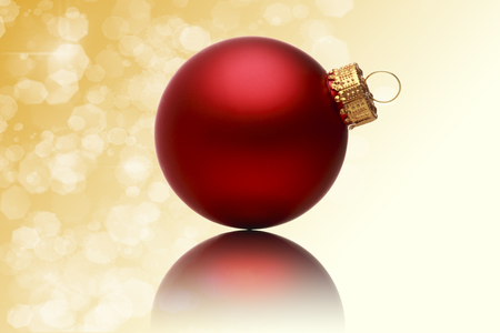 close up of a red christmas ball with blurred yellow background. photo