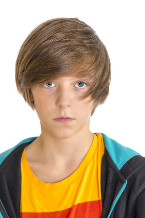 Closeup of a cute teenage boy looking into the camera, isolated on white. Standard-Bild