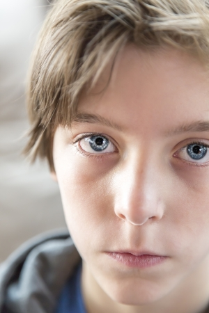 close up portrait of a male teenager with big blue eyes. Stockfoto