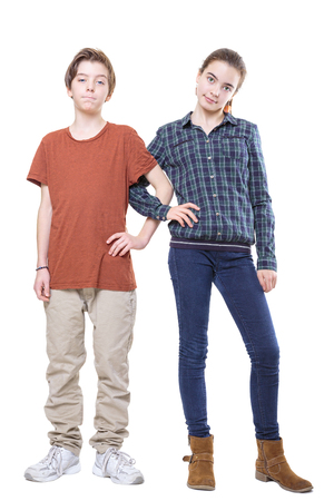 brother and sister standing with linked arms, isolated on white. Stock Photo - 24758718