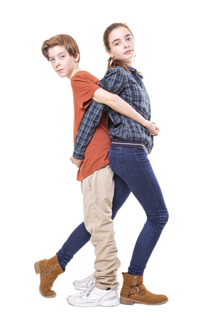mutually: brother and sister back on back, isolated on white. Stock Photo
