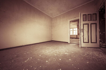 dirty room: fish eye shoot of a empty dirty room with sepia color filter.