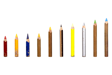 old pencil: collection of old used short multi colored crayons, isolated on white. Stock Photo