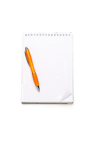 open blank note pad with ring binder and ball pen, isolated on white. photo