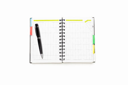 ball pen: open schedule with ring binder and ball pen, isolated on white.#