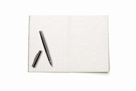 blank open squared text book with japan brush pen, isolated on white. photo