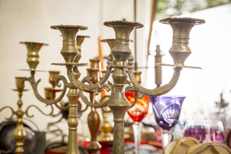 old candle stand out of brass on a flea market  Imagens