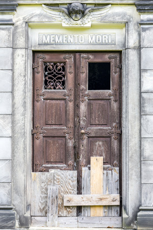 crypt: boarded up door to a crypt. Stock Photo
