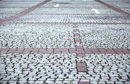 cobblestone pavement with white arrows. photo