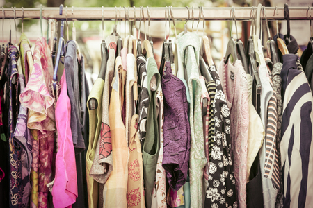specific clothing: clothes on a rack on a flea market.