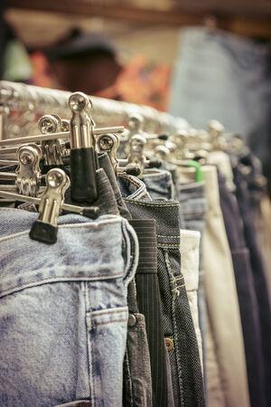 clothes rack: clothes on a rack on a flea market.