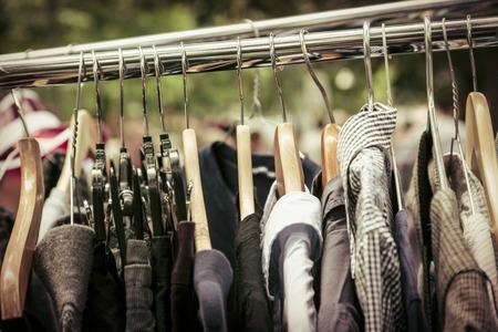 clothes on a rack on a flea market. photo