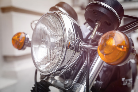 close up of a motorcycle headlight with blinker light photo