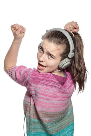 enthusiastic teenage girl with headphones, isolated on white