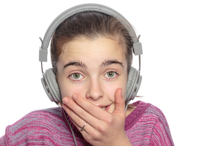 self conscious: funny  embarrassing touched teenage girl with headphones, isolated on white