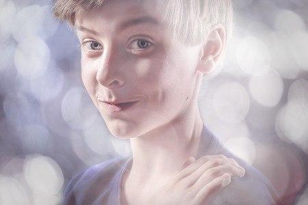 canny: portrait of a lucky teenage boy, with bokeh around