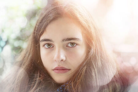 portrait of a teenage girl with light leak and bokeh