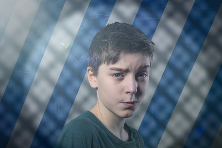 canny: portrait of a doubting teenage boy with flare, striped background and shadow pattern