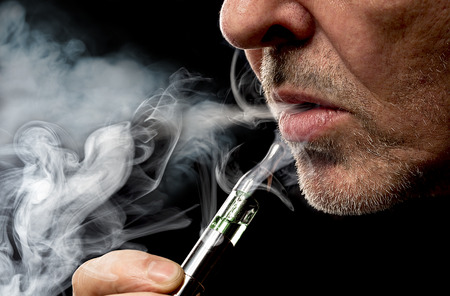 close up portrait of a man smoking an e-cigarette 写真素材