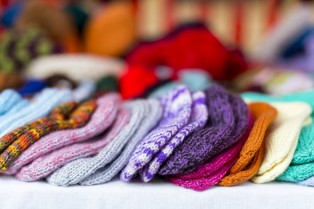 place for children: a  row of multicolored hand-knitted baby socks Stock Photo