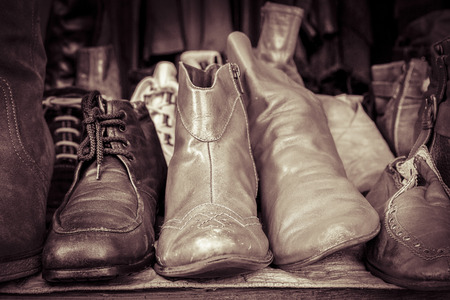 specific clothing: some old shoes on a flea market stall