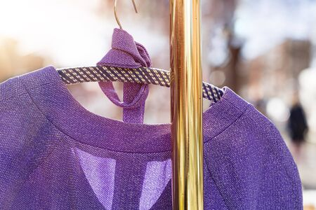 clotheshanger: pullover hanging on a wardrobe rail on a flea market