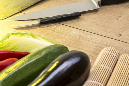 still life with eggplant, zucchini and kitchen knife photo