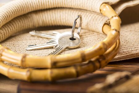 shelve: still life with house key and bamboo handles of a shopping bag