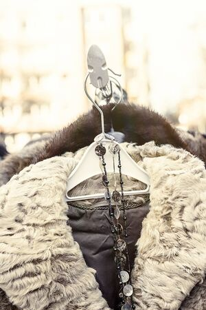 specific clothing: winter jacket with fur collar on a flea market