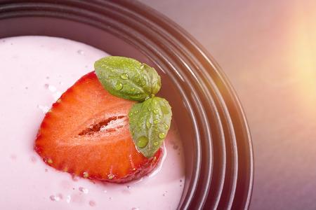 quark: quark with strawberry in a black asian bowl
