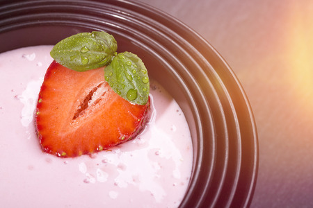 asian bowl: quark with strawberry in a black asian bowl