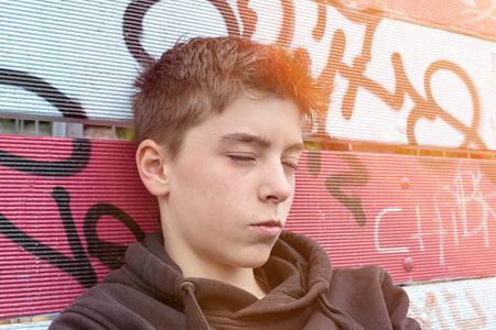 grunge teenager: portrait of a sleeping teenage boy