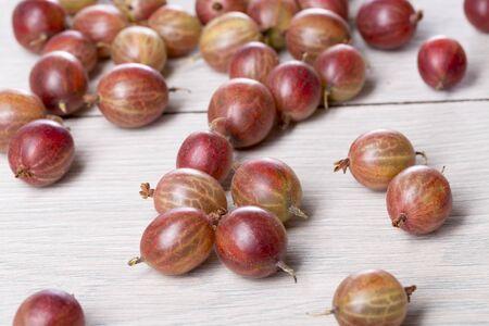 gooseberries: some fresh gooseberries on a table