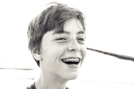 handsome boys: portrait of a laughing teenage boy with a brace Stock Photo