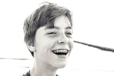portrait of a laughing teenage boy with a brace Reklamní fotografie