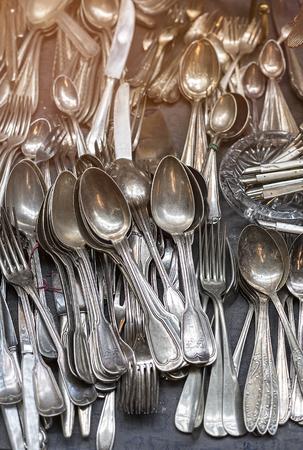 fleamarket: bunch of old silver ware on a flea market