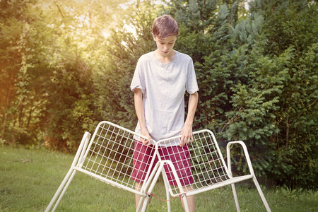 two chairs: lonely teenage boy with two chairs