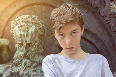 cool guy: old and young, portrait of a teenage boy with sculpture of an old man. unknown artist of the 18th Stock Photo