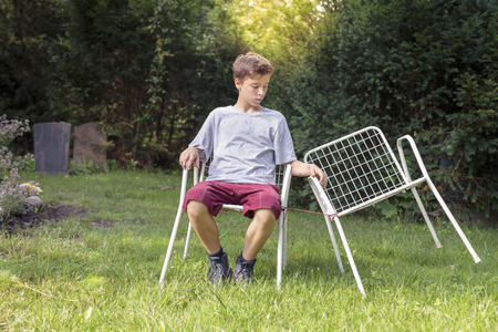 lonely: lonely teenage boy with two chairs