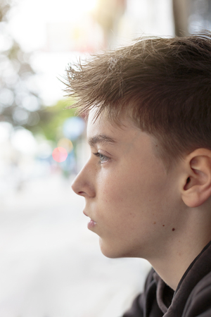 cool guy: portrait of a teenage boy in profile Stock Photo