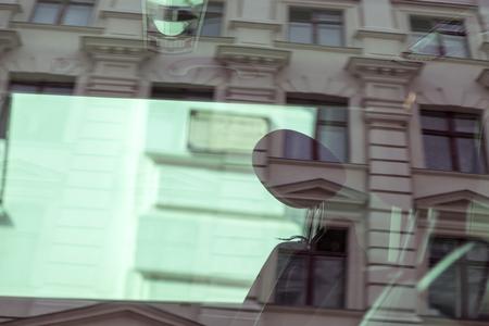 renovate old building facade: facade of a house seen through a car window