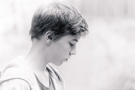 cool guy: high key black and white portrait of a teenage boy Stock Photo