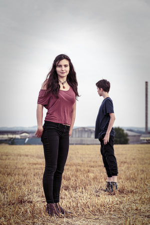mutually: vintage shot of two teenager on a harvested field
